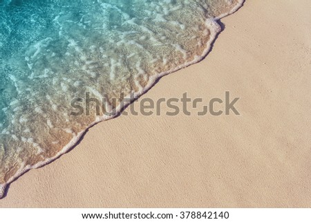 Soft wave of blue ocean on sandy beach. Background. #378842140