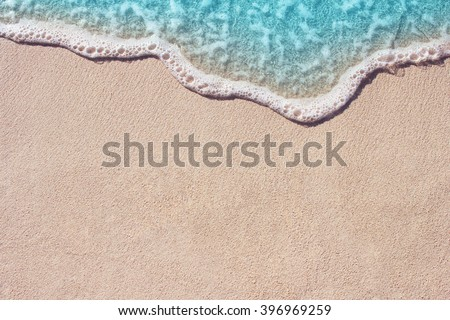 Soft wave of blue ocean on sandy beach. Background. - Shutterstock ID 396969259