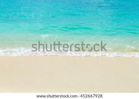 Soft wave of blue ocean on sandy beach. Background. #452667928