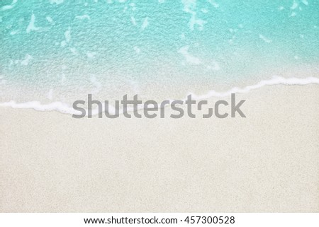 Soft wave of blue ocean on sandy beach. Background. #457300528