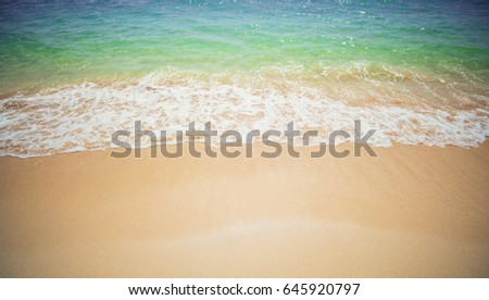 Soft Wave Of Blue Ocean On Sandy Beach. Background.  #645920797