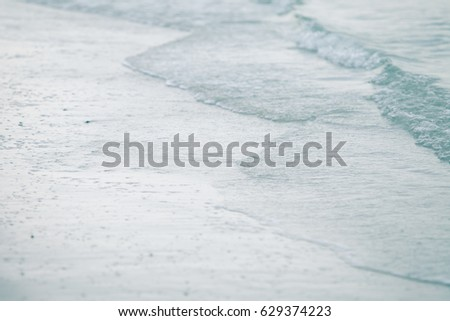 Soft wave of blue ocean on sandy beach,Background,landscape,water  blue sea. #629374223