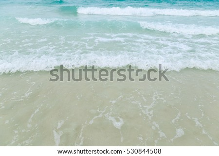 Soft wave of blue ocean on sandy beach. Background, Pattaya Thailand #530844508