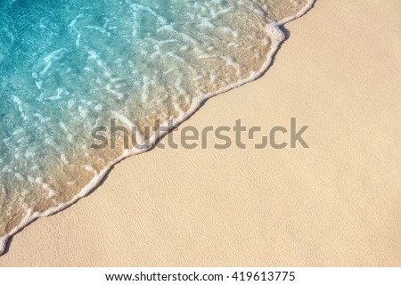 Soft Wave Of Blue Ocean On Sandy Beach. Background. Selective focus. #419613775