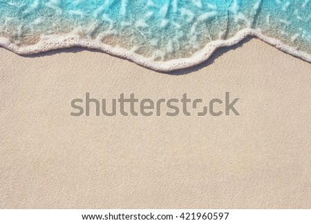Soft Wave Of Blue Ocean On Sandy Beach. Background. Selective focus. #421960597