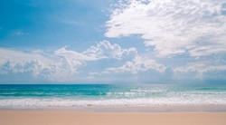 Soft wave of blue ocean on sandy beach in summer season. Background with blue sky and sun daylight relaxation landscape viewpoint