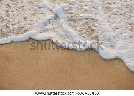 Soft Wave Of ocean on sandy beach background #696415438
