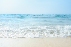 Soft wave of ocean on sandy beach, copy space, background.