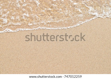 Soft wave of ocean on sandy beach. Nature background. Flat lay concept. Place for your text #747012259