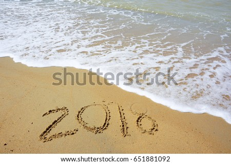 Soft wave of ocean on sandy beach with year 2018 #651881092