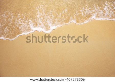 Soft wave of the sea on the sandy beach #407278306