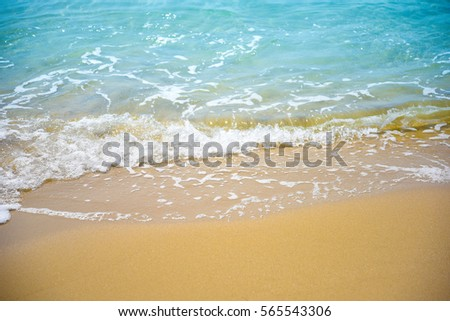 Soft wave of the sea on the sandy beach. Sea, wave and beach, famous beach in south of Thailand. #565543306