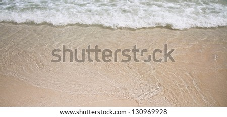 Soft wave on the beige sand background