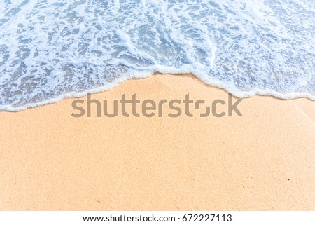 Soft wave with blue ocean on sandy beach. Empty space can be used as background for display or montage your top view products. #672227113