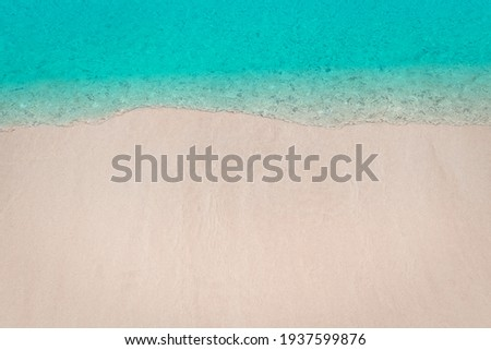 Soft waves of blue sea and sand on summer holidays beautiful beach with free space, Background, Design for backdrop or wallpaper and billboard, Travel concept, Selective focus
