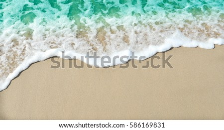 Soft waves on the sand beach  #586169831