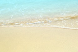 Soft white blue sea wave on clean brown sandy beach coast have copyspace