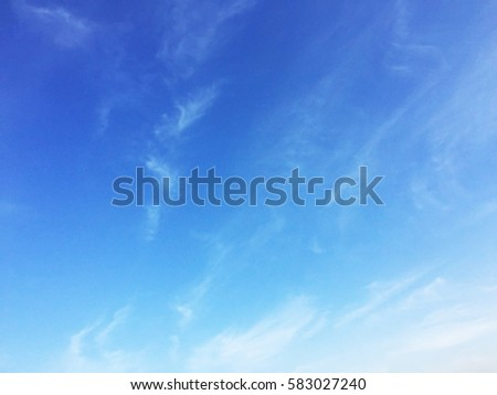 Soft white clouds against blue sky background and empty space for your design. #583027240