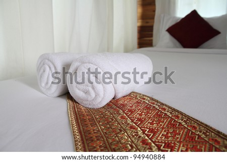 soft white towels, rolled and piled - stock photo