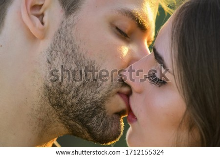 Softer than silk. delicate gorgeous kiss. man kiss woman. couple in love. I love you. Closeup mouths kissing. romantic relations. married couple kissing love on honeymoon. kissing couple portrait.