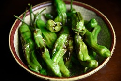 Softly charred green shishito peppers