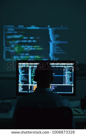 Software developer working in office late at night