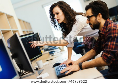 Software engineers working on project and programming in company #746959522