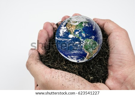 Soil and earth in hand on white background, earth day concept. Elements of this image furnished by NASA
