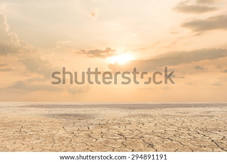 Stock Photo Soil drought cracked landscape sunset