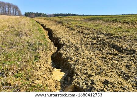 Soil erosion erosive groove in field road, damaged earth in farmer land. Photo stock ©