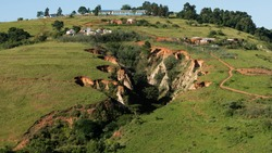 Soil erosion leading up to a school