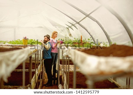soil fertilizer. soil fertilizer production. natural soil fertilizer in greenhouse. soil fertilizer with family in orangery. people gardening #1412595779