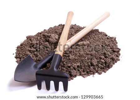 Soil for seedling and decorative tools on a white background