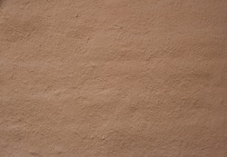 Soil wall texture of clay house structure. building from mud. soft picture