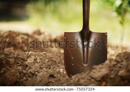 Soil with shovel. Close-up, shallow DOF.