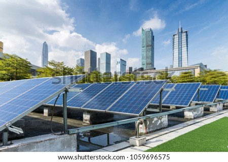 Solar and modern city skyline