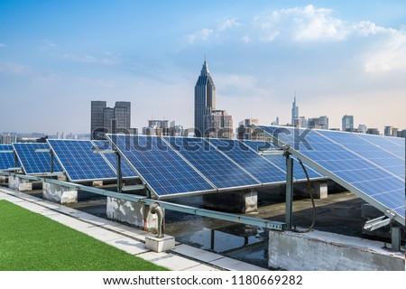 Solar and modern city skyline  #1180669282