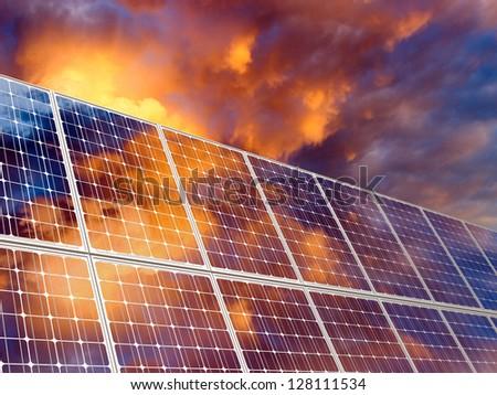 Solar battery on sunset sky background.