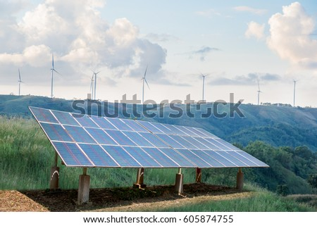 Solar cell energy panels and Windmills energy on the peak of mountain. Alternative and sustainability of enery from natural.