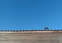 solar cell or Photovoltaics module (PV module, Solar module) on the roof with blue sky background.