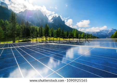 Solar cell panel in country landscape against sunny sky and mountain backgrounds. Solar power is the innovation for sustainability of world energy. Sustainable resources. #1090925165