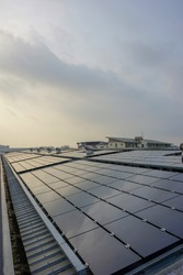 Solar cell panel on factory rooftop