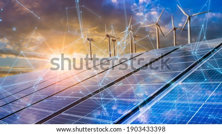 solar cell plant and wind generators in urban area connected to smart grid.Energy supply,eolic turbine,distribution of energy,Powerplant,energy transmission, high voltage supply concept.