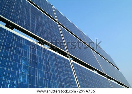 Solar cells against blue sky