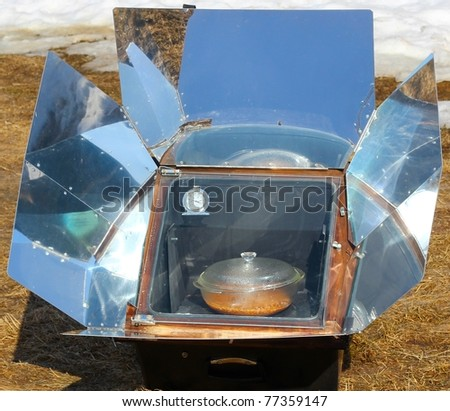 Solar cooking with a solar oven on a sunny day