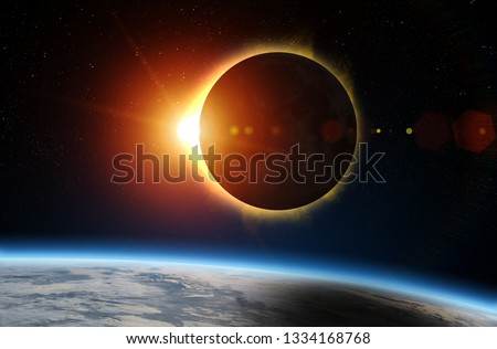 Solar Eclipse and Earth. Solar eclipse, mysterious natural phenomenon when Moon passes between planet Earth and Sun. Elements of this image furnished by NASA. #1334168768