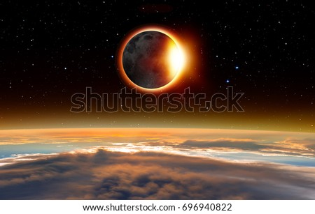 "Solar Eclipse ""Elements of this image furnished by NASA "" #696940822"
