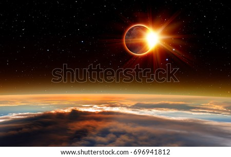 "Solar Eclipse ""Elements of this image furnished by NASA "" #696941812"
