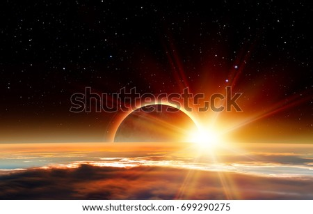 "Solar Eclipse ""Elements of this image furnished by NASA "" #699290275"