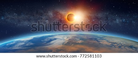Solar Eclipse  in front of the Milky Way galaxy